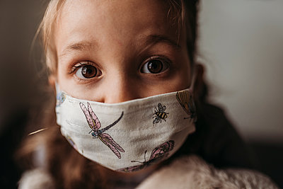 Detailed close up portrait of young girl with mask on - p1166m2207793 by Cavan Images