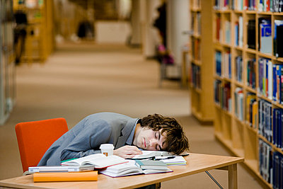 A student who has fallen asleep in a library Sweden - p31222798f by Plattform