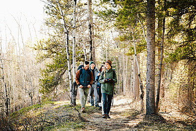 Friends hiking in woods - p1192m2094000 by Hero Images