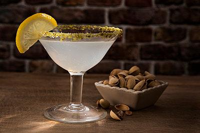 Glass of Lemon Drop Martini with pistachio - p300m2041746 by Carmen Steiner