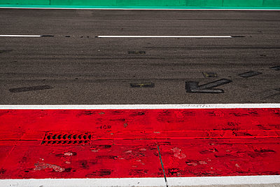 Markings and gully on racetrack - p300m2060045 by Hans Mitterer