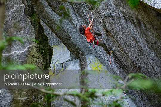 Climber on Dreamcatcher on the Cacodemon boulder Squamish, British Columbia, Canada - p924m2271147 by Alex Eggermont