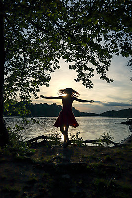 Woman dancing near the river - p1019m2098804 by Stephen Carroll
