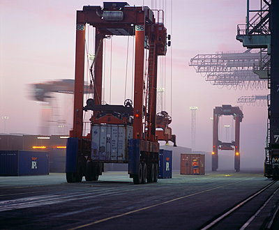 Container port with fog - p416m991092 by Dominik Reipka