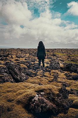 Woman in a lava field - p470m2082312 by Ingrid Michel