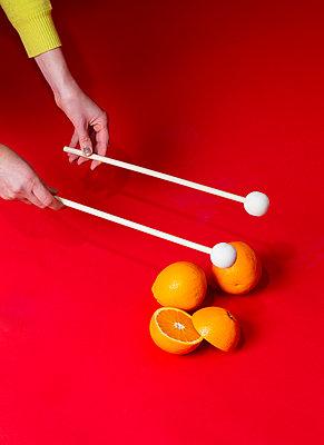 Hand, Drumsticks and orange - p801m2257699 by Robert Pola