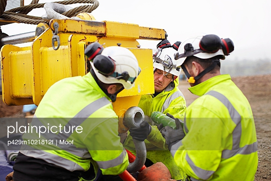 Engineers working on wind turbine - p429m1021812f by Moof
