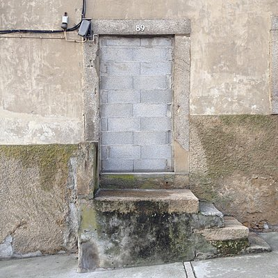Bricked up door, Porto, Portugal - p1401m2172694 by Jens Goldbeck