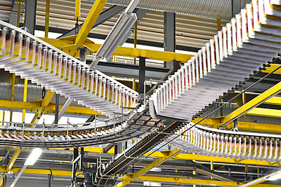 Conveyor belts with newspapers in a printing shop - p300m1068794f by lyzs