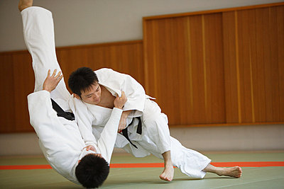Two Men Competing in a Judo Match - p3070561f by Score. by Aflo