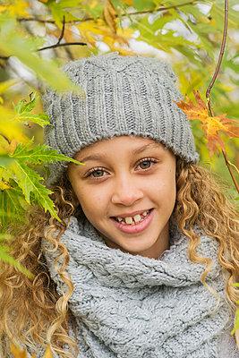 Portrait of a girl in a park, Autumn - p1323m1190227 by Sarah Toure