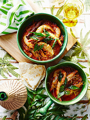 Casserole of prawns and garnish with glass of Indian coconut vinegar - p429m1012789f by BRETT STEVENS