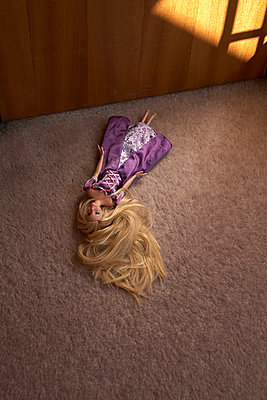Barbie doll on the carpet - p1612m2223531 by Heidi Coppock-Beard