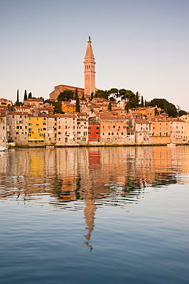 The Cathedral of St. Euphemia and Venetian style buildings in Rovinj reflected in the sea at sunrise, Rovinj, Istria, Croatia, Europe - p8710066 by Ellen Rooney