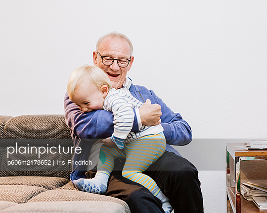 Fooling around with grandpa - p606m2178652 by Iris Friedrich