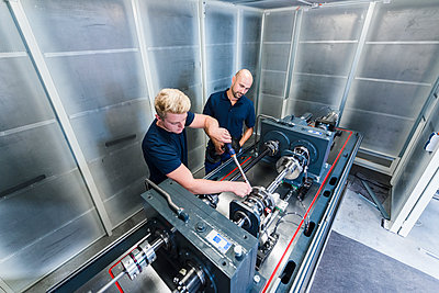 Two colleagues working in modern factory - p300m1505561 by Daniel Ingold