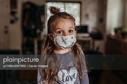 Close up portrait of young preschool aged brunette girl with mask on - p1166m2207802 by Cavan Images