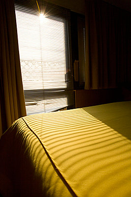 Bed in a hotel room in Italy - p3313586 by Andrea Alborno