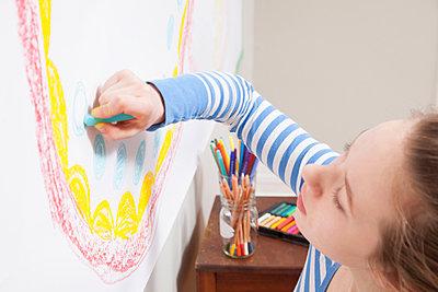Girl drawing on wall - p924m805882f by davidgoldmanphoto