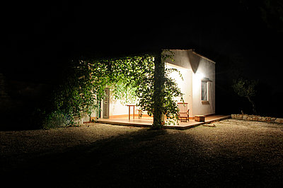 Illuminated corner of villa  - p1072m829281 by Neville Mountford-Hoare