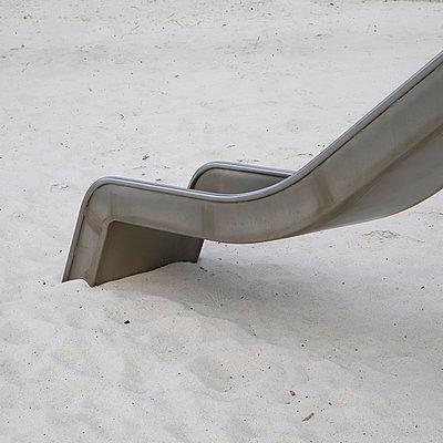 Slide in the sand - p1105m2278336 by Virginie Plauchut