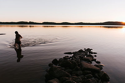 Walking in the water - p1507m2168026 by Emma Grann