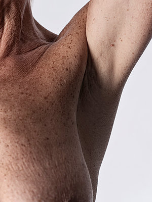 Armpit of a woman - p1383m2167950 by Wolfgang Steiner