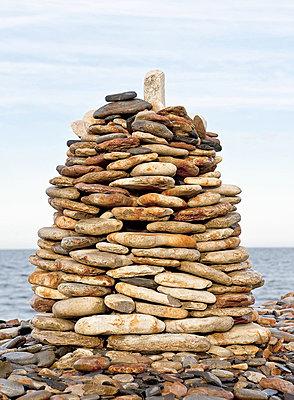 A cairn at the shore, Sweden. - p4551438f by Bengt Kallenberg
