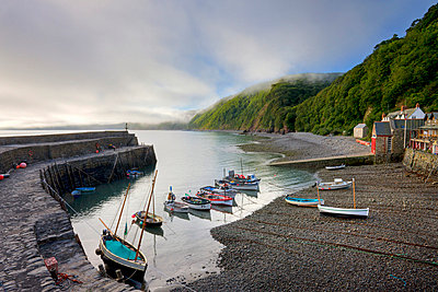 Fishing boats moored in the harbour at Clovelly, Devon, England, United Kingdom, Europe - p8712982 by Adam Burton