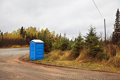 A portable toilet on the side of the road;Ontario canada - p442m837593f by Benjamin Rondel