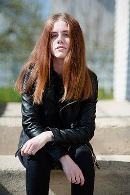 Teenage girl in a black leather jacket - p1412m2200548 by Svetlana Shemeleva