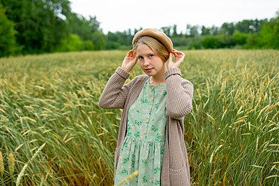 Woman in a cornfield - p1646m2260613 by Slava Chistyakov