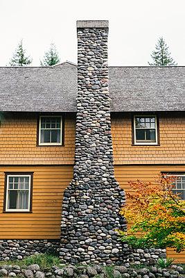 Orange House with Stone Fireplace - p694m2068413 by Joyelle West