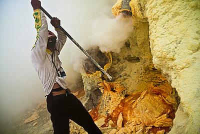 Sulphur miner at the Kawah Ijen Sulphur Mines in East Java - p934m1022327 by Dominic Blewett