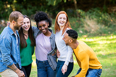 Smiling group of friends having fun in public park - p623m2294848 by Eric Audras