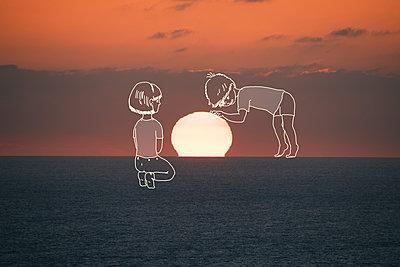 Imaginary children touching setting sun - p1165m1216894 by Pierro Luca