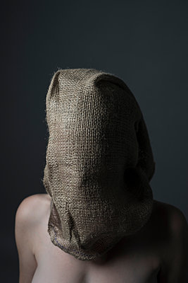 Non-explicit topless woman with her head in a hessian bag. - p1433m1589011 by Wolf Kettler