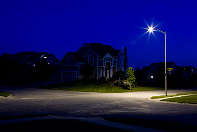 Suburban houses at night - p3018340f by Patrick Strattner