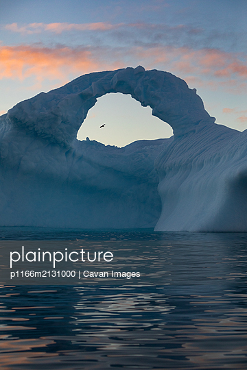Window in iceberg - p1166m2131000 by Cavan Images