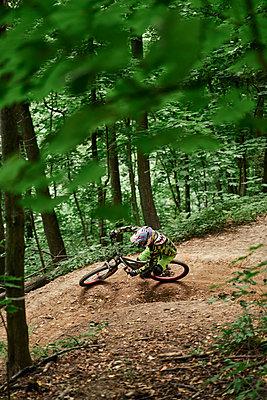 Mountainbiker at full speed - p1630m2289097 by Sergey Mironov