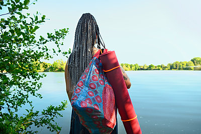Woman by the lake - p427m2203635 by Ralf Mohr