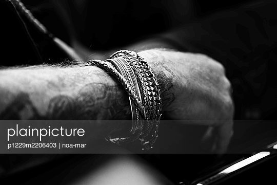 Man with bracelets and tattoo - p1229m2206403 by noa-mar