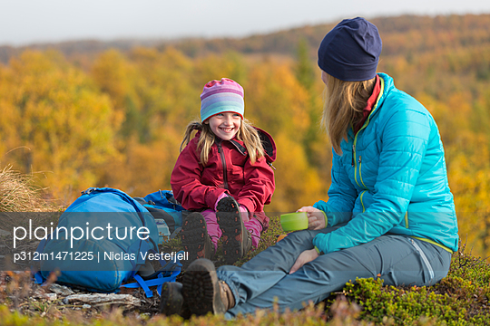 Mother with daughter resting - p312m1471225 by Niclas Vestefjell