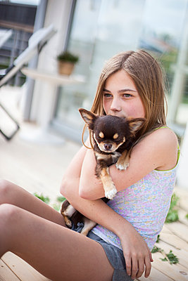 Girl with dog - p312m1470724 by Christina Strehlow