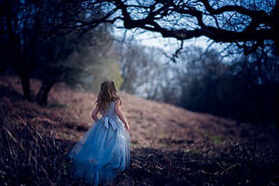 Girl in a Blue Dress in a Dark Forest - p1459m1525788 by Zoe Space