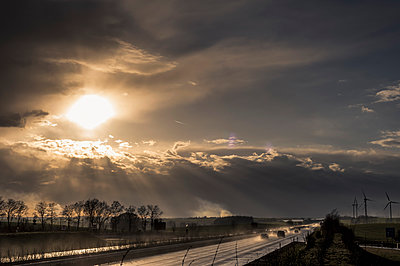 Stormy atmosphere over motorway at evening twilight - p300m1494809 by Jana Mänz