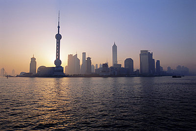 City skyline, Oriental Pearl tower and Pudong from across the Huangpu river, Shanghai, China, Asia - p8711256 by Neil Emmerson