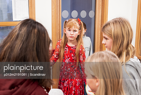 Girls talking at school - p312m2191081 by Scandinav