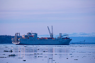 Military cargo ship traveling up Knik Arm to the port of Anchorage at high tide, Anchorage, Southcentral Alaska, USA. - p442m1033951 by Design Pics