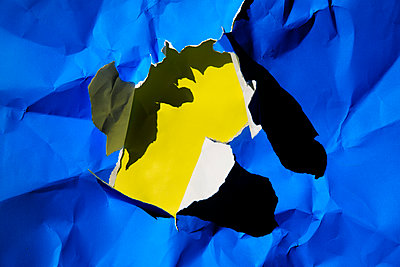 Crumpled paper with hole - p801m2257684 by Robert Pola